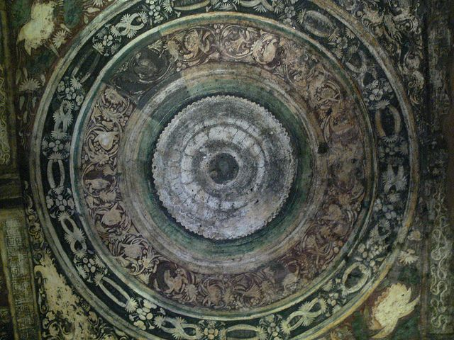 Painted ceiling from a Cave Temple at Ajanta enclosing lotus flowers