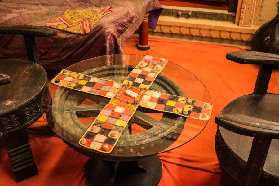 Chaupar-chopad is a cross and circle board game similar to pachisi, played in India. The game board display in Patwon Ki Haveli.